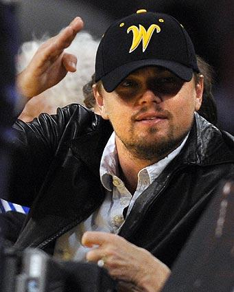 Leonardo DiCaprio watches action between the Los Angeles Lakers and the Orlando Magic during the first half of Game 1 of the NBA Finals.