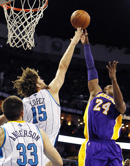 Lakers guard Kobe Bryant scores over Hornets center Robin Lopez to surpass 30,000 points in his career.