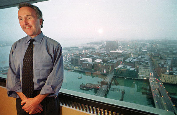 Land developer Frank McCourt stands in front of a window of his office in Boston in 2001. McCourt, president and chief executive of the McCourt Co., reached an agreement to purchase the Dodgers from Rupert Murdoch's News Corp., in October 2003.