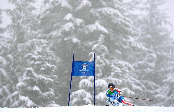 Sarah Schleper of the United States rounds a gate during the first run of the women's giant slalom at Whistler in the 2010 Vancouver Olympics.