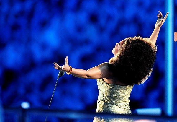 Canadian soprano Measha Brueggergosman sings the Olympic anthem.