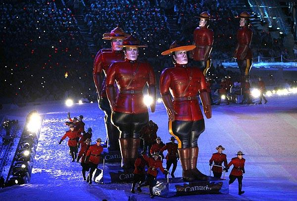 Inflatable figures of Royal Canadian Mounted Police officers are guided by performers dressed as Mounties, providing a singularly Canadian image to the Vancouver 2010 Winter Olympics closing ceremony Sunday night.