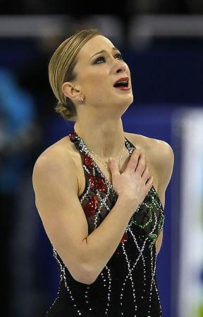 Canada's Joannie Rochette, whose mother died of a heart attack last week, fights back tears after finishing her short program during the women's figure skating competition Tuesday night at the Pacific Coliseum in Vancouver.