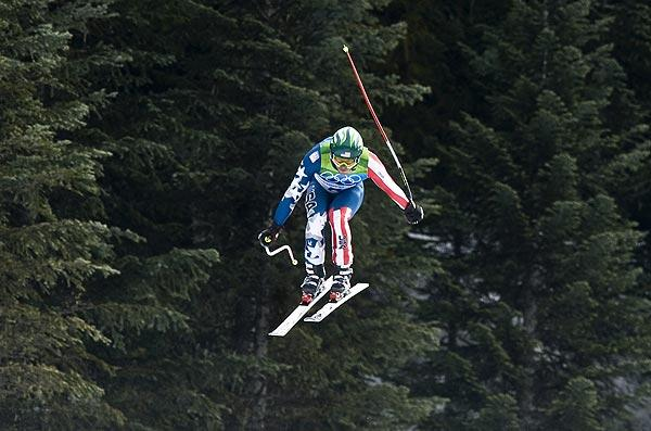 The USA's Bode Miller heads over the last jump to win the bronze medal in the men's downhill competition at the 2010 Winter Olympics on Monday.