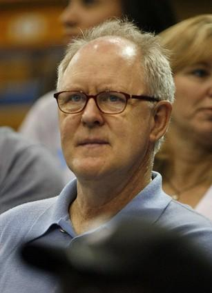 Actor John Lithgow watches UCLA play basketball against Michigan.