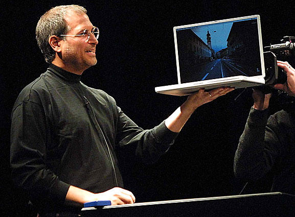Jobs unveils a new titanium G4 Powerbook with a 15.2-inch screen at the 2000 MacWorld Expo in San Francisco. He also announced new configurations of the G4 desktop Macs as well as new audio and DVD software.