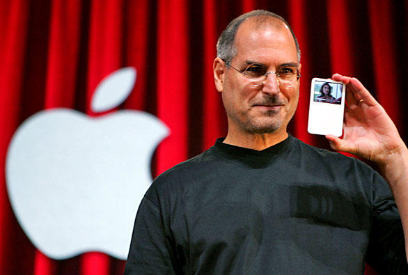 "Jobs holds up the new iPod, showing an episode of hit television show ""Desperate Housewives."" Apple Computer Inc.'s momentum in 2005 seemed unstoppable as it launched one hit product after another: the iPod Shuffle, the Mac Mini, the iPod Nano, a video-playing iPod and TV shows for sale on its iTunes store."