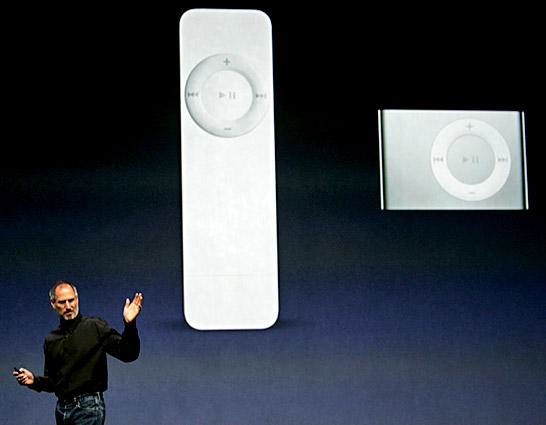 Jobs announces a new iPod Shuffle, right, and compares it to the the older Shuffle, left. He also announced a new iPod nano with a 24-hour battery life and new games for the portable media player.