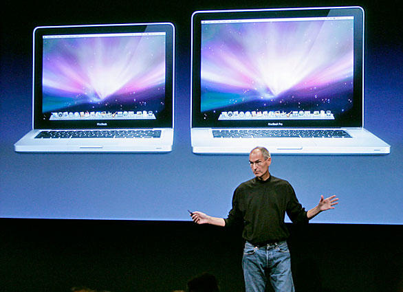 Jobs introduces new versions of the MacBook, left, and MacBook Pro at Apple headquarters in Cupertino, Calif.