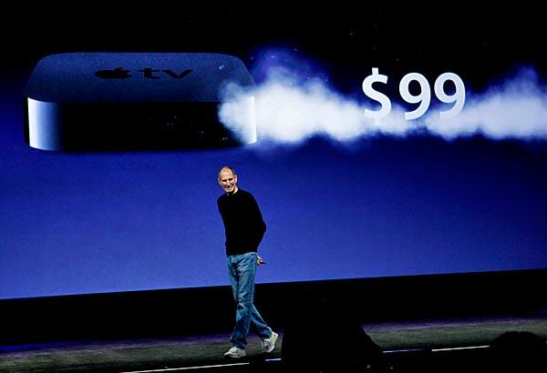 "Jobs announces the $99 Apple TV device, with 99-cent online TV show rentals. The majority of Hollywood studios, and two broadcast networks -- CBS and NBC -- declined to allow their shows to be included. ""Not all of them wanted to take this step with us,"" Jobs said. ""We think the other studios will see the light."""
