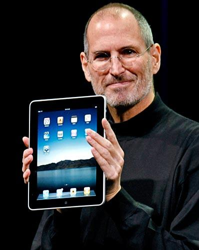 "Jobs holds up the iPad, a portable device for reading books, watching video and surfing the Web, at its unveiling in San Francisco. ""We think we've got the goods. We think we have done it,"" he said."