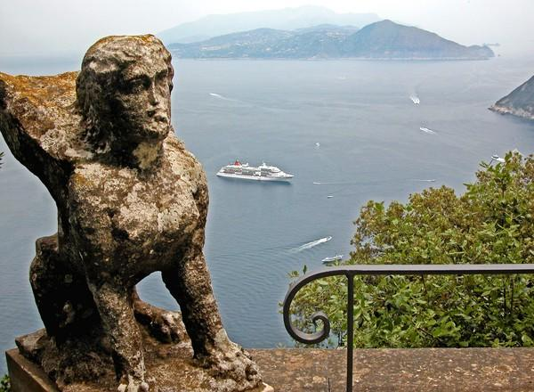 A ship sails toward Capri, Italy, far below this viewpoint at the Villa San Michele, one of Capri's most popular tourist destinations.