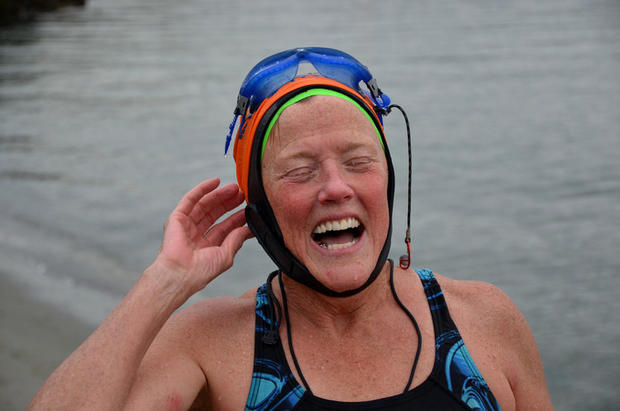 "At Golden Gardens Beach, Seattle, 56-year-old swimmer Guila Muir emerges from a dip in Puget Sound. She swims one to two miles four times and week. ""I'm practicing for a 5K in Alaska,"" she said."