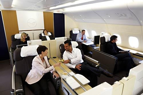 "<i>First Class</i><br> <br> Lufthansa designed its first-class cabin to make passengers forget they're flying. Noise-reducing materials within the cabin walls and sound-absorbing carpeting create what the airline calls ""the world's quietest first-class cabin."" Cabin lighting adjusts according to the time of the day.<br> <br> Unlike Singapore and Emirates, Lufthansa steered away from enclosed suites in first class. Basing its design on tests and surveys, Lufthansa chose an open layout that places passengers in a communal setting.  The airline eliminated overhead storage units to increase headroom, replacing them individual closets."