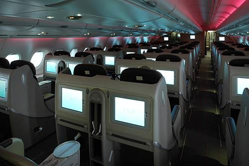 <i>Business class</i><br> <br>  Passengers in this class have a private storage area, 15-inch video screen, adjustable light and access to two bars.