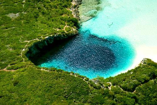 There may be bigger and more impressive blue holes, but Dean's Blue Hole on Long Island in the Bahamas is the world's deepest at more than 600 feet deep.<br> <br> Blue holes, named for their vibrant color as seen from above, are subsurface voids that contain fresh, marine or mixed waters that extend below sea level. They are open to the surface and may provide access to submerged caves.<br> <br> -- Kelsey Ramos, Los Angeles Times