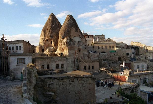 "A popular attraction in central Turkey, Cappadocia is known for the fairy-tale-like rock formations that bespeckle the region. Called fairy chimneys, or hoodoos, these formations have been carved by erosion over the millennia. Fairy chimneys can be found in other parts of the world such as Bryce Canyon in Utah or Badlands National Monument in South Dakota, but Cappadocia's early inhabitants turned them into an extensive network of homes and churches.<br> <br> Christians fleeing Roman persecution took refuge in Cappadocia's rocky terrain early in the first millennium. By the 4th century, a monastic community formed in central Cappadocia.<br> <br> Read more: <a href=""http://www.latimes.com/travel/la-tr-offbeattraveler12-pg,0,5064851.photogallery"">Cappadocia's alien-like landscape</a><br> <br> <i>Pictured: Examples of Cappadocia's fairy chimneys.</i>"