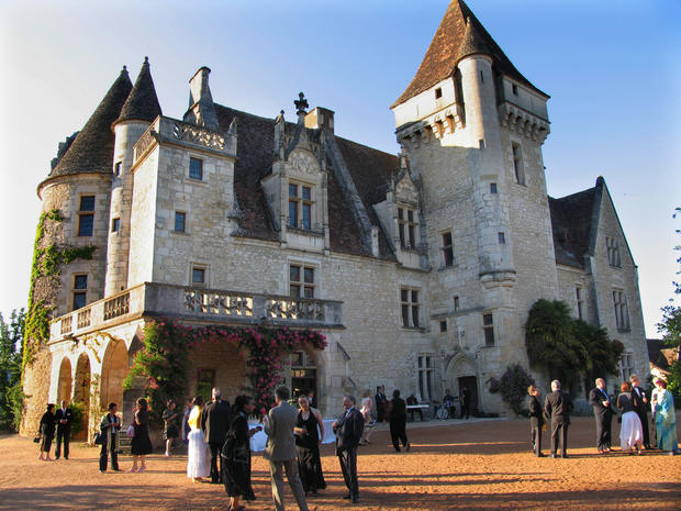The late Gothic/early Renaissance castle was built in 1489 by François de Caumont for his wife, Claude de Cardaillac. But like other embellishments, the medallions that honor him on the chimney of the small dining room were added by a later owner, Charles Claverie, who began a full-scale restoration in 1900.<br>