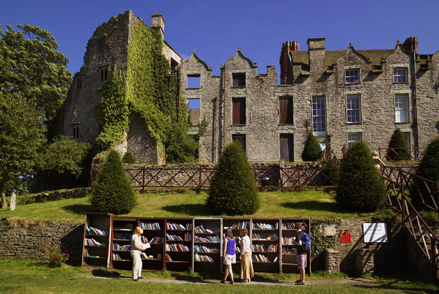 "In the early 1960s, while still a lad in his early 20s, Richard Booth, an eccentric anarchist and Oxford graduate with an abiding love for books, declared Hay a ""book town"" and opened a secondhand bookshop. Later, he bought 800-year-old Hay Castle and declared himself king of Hay. King Richard's vision was to create a ""town of books"" that would lure visitors to the banks of the River Wye and give his kingdom an economic foundation.<br>