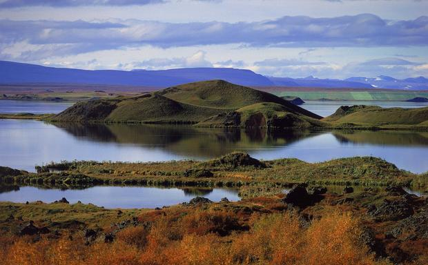 "Myvatn, near the town of Akureyri (riddled with consonants, Icelandic words are not easy to tackle, but saying ""mee-VAHT"" and ""ah-KOO-ray-ree"" will get you by), is more or less on top of the ever-growing chasm between the North American and Eurasian plates. In the '70s and '80s, this region fielded nine eruptions from a nearby series of volcanic fissures. Locals had to put their tap water in the fridge to cool.<br>