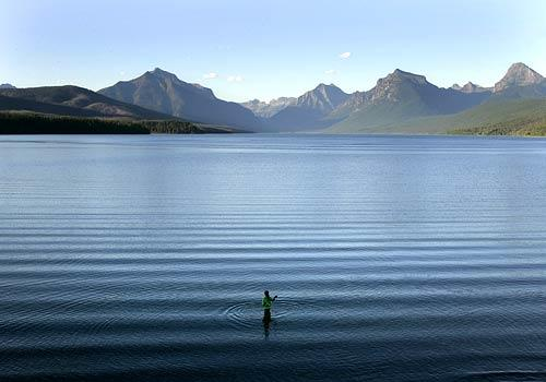 A swimmer ventures into Glacier National Park's Lake McDonald, its surface ruffled by an unseen boat, near Apgar village, not far from the park's west entrance. To visit Glacier is to find a glorious combination of the wild and the civilized, a place where the hand of man is surprisingly at home in a world teeming with predators and untrammeled nature.