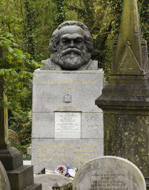 A bust  of Karl Marx marks the grave of the revolutionary socialist in London's Highgate Cemetery, which is in all the tour guides for the city.