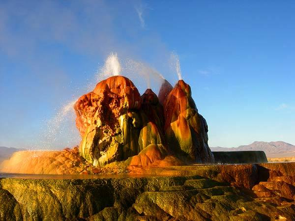 "This Nevada desert's picturesque mountains and sparkling geysers are well-known backgrounds for the annual radical arts Burning Man festival.<br> <br> Fly Geyser (pictured),  which is on a private ranch, is one of the  strangest and most beautiful parts of the desert, spouting groundwater from a vivid orange and green calcium carbonate deposit base. The ""geyser"" is actually a man-made accident that began when a geothermal power company drilled a test well and improperly plugged the hole.<br> <br> Despite its alluring mystic appeal, the desert is still unforgiving. Visitors are advised to stay away from geysers (which can reach deathly hot temperatures) and to carry enough supplies to ensure survival if they get lost.<br> <br> -- Kelsey Ramos"