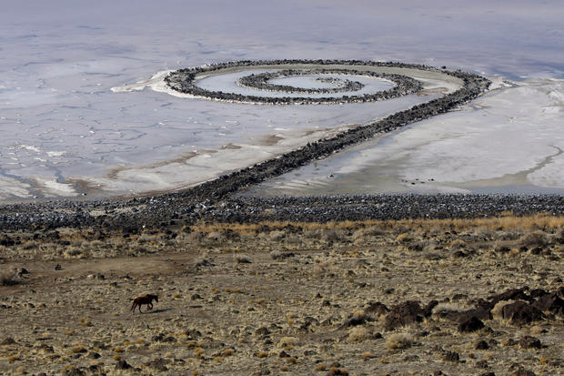"""Spiral Jetty"" earthwork: Thirty miles west of Brigham City, on the Great Salt Lake's northern arm, is the ""Spiral Jetty"" sculpture, created from basalt and earth by artist Robert Smithson in 1970. It forms a 1,500-foot-long coil stretching into the lake. Constructed during a long drought, ""Spiral Jetty"" became submerged a few years later when lake levels rose again. In 1999, it resurfaced. For directions, see <a href=""http://climb-utah.com/wm/spiraljetty.htm"">climb-utah.com/wm/spiraljetty.htm</a>."