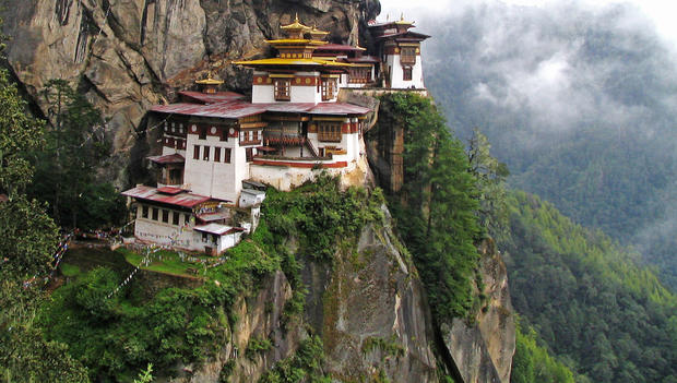 "Taktsang Monastery, also known as the Tiger's Nest, clings to the slide of a cliff about 10,000 feet above ground in Bhutan's Paro district. The monastery was built in the 17th century and damaged in a fire in 1998.<br> <br> Visitors can reach the monastery by mule ride or by foot. Walking takes about two hours from the base of the trail. The monastery is still used, and entry is restricted.<br> <br> More info: <a href=""http://www.tourism.gov.bt/destinations/brief-description-5.html"">http://www.tourism.gov.bt/destinations/brief-description-5.html</a><br> <br> -- Jason La"