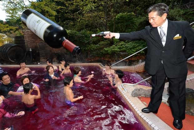 Sommelier Shunji Kanaya pours Beaujolais nouveau into the wine spa.