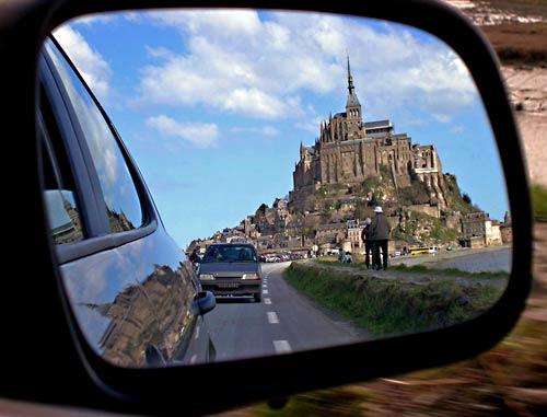 "A serendipitous glance in the side-view mirror of her rental car enabled Whitney Huss to capture a last look at Mont-St-Michel as she and her parents were leaving after a day trip to the tidal island off France's Normandy coast. The Culver City resident says the ""image represents Mont-St-Michel's imposing aesthetic -- as if the two tourists on the right are forced to stop and stare at its beauty."" She used a Nikon Coolpix 3700."