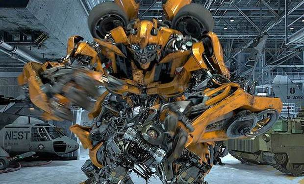 Concept art for the new Transformers ride at Universal Studios Hollywood shows Bumblebee in action surrounded by military planes, tanks and helicopters.