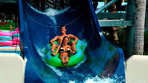 The dual 48-foot-tall Proslide Pipeline slides at SeaWorld San Antonio feature single and double inner tubes that pass under waterfall curtains.