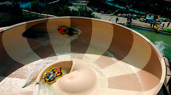 A pair of Proslide Bowl tube slides at SeaWorld San Antonio will deposit riders inside a large bowl.