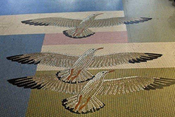 Seagulls add a bit of nature to the mosaic floors designed by Works Progress Administration artist Grace Clements.