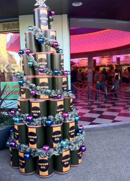 A Christmas tree built out of giant oil cans stands in front of the Flo's V8 Cafe in Cars Land at Disney California Adventure.