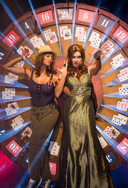 Fashion model and talk show host Tyra Banks spins the wheel of fate with Halloween Horror Nights 21 host Lady Luck at Universal Studios Florida.