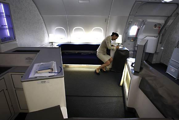 <i>Business class</i><br> <br> Business class features two bars: a self-service bar at the front of the cabin and the hosted Celestial Bar, pictured, at the rear.