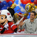 Green Bay Packers quarterback Aaron Rodgers celebrates his Super Bowl win at the Magic Kingdom.