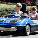 Singer Britney Spears takes on spin on the Tomorrowland Speedway with her children at the Magic Kingdom.