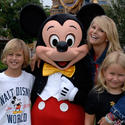 Supermodel Christie Brinkley strikes a pose with Mickey Mouse.