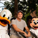"""Daily Show"" host Jon Stewart barely contains his bemusement as he poses with Donald Duck and Minnie Mouse in ""Star Wars"" attire."