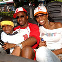Rapper Sean Combs (a.k.a. Puff Daddy, Puffy, P. Diddy, Diddy) takes his family for a ride on Tomorrowland Speedway at the Magic Kingdom.