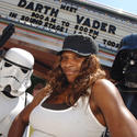 "Tennis star Serena Williams receives an armed escort from Darth Vader and a ""Star Wars"" stormtrooper at Disney's Hollywood Studios."