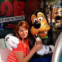 """30 Rock"" Tina Fey shares a chocolate shake with Goofy at the Sci-Fi Dine-In Theater at Disney's Hollywood Studios."