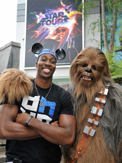 "Orlando Magic center Dwight Howard and ""Star Wars"" wookiee Chewbacca compare heights at Disney's Hollywood Studios."