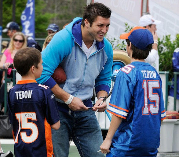 Denver Broncos quarterback Tim Tebow signs autographs for young fans during ESPN Weekend at Disney's Hollywood Studios.