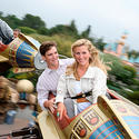 New York Giants quarterback Eli Manning rides the Astro Orbitor at Disneyland with his wife, Abby.