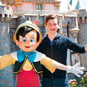 """Glee"" star Chris Colfer poses with his dopplegagger, Pinocchio, at Disneyland."