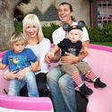 No Doubt singer Gwen Stefani and rocker-husband Gavin Rossdale of Bush aboard a pink tea cup with their family at Disneyland.